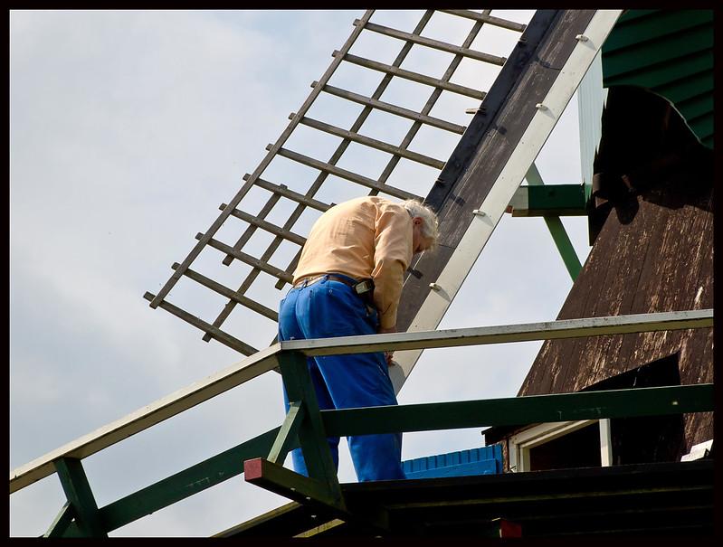 Craftsmen repair the windmill