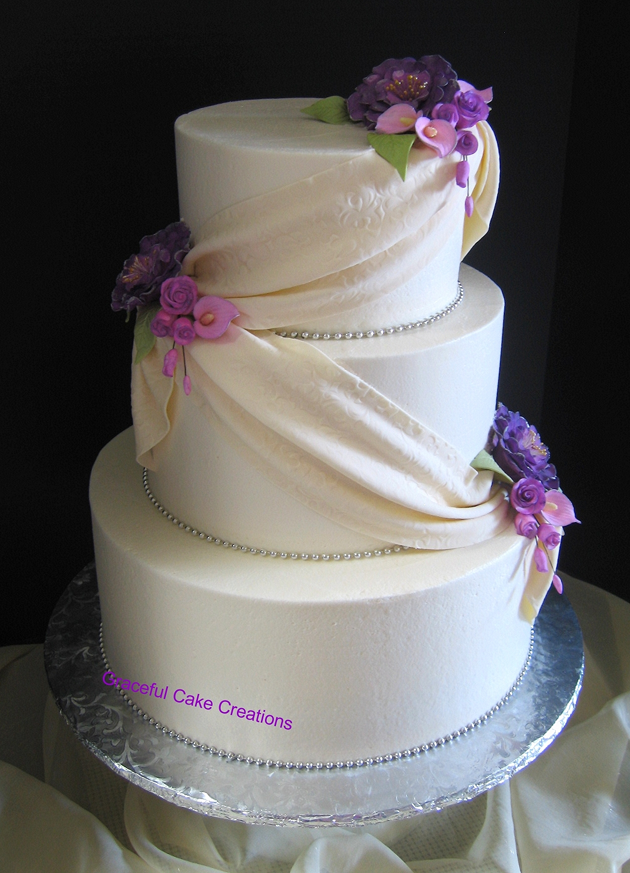 Elegant Ivory Wedding Cake with Purple Peonies Lavender