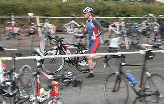 Image of a triathlon in transition between the cycle and the run