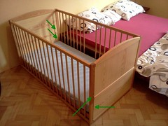 studio couch(0.0), stairs(0.0), floor(1.0), bed frame(1.0), furniture(1.0), room(1.0), infant bed(1.0), bed(1.0), hardwood(1.0), baby products(1.0),