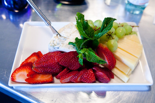 Platter of blue cheese, Pecorino cheese, green grapes and fresh strawberries