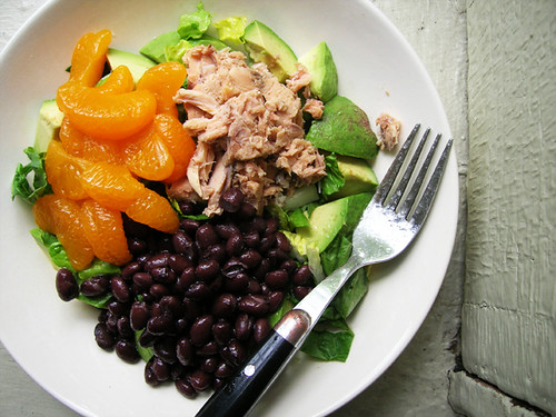 green salad with salmon, black beans, and mandarin oranges