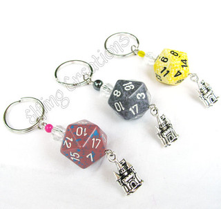 Castle dice keychains- yellow, grey, pink