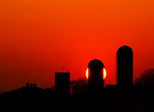 red sun ontario canada silhouette landscape photography warm farm silo