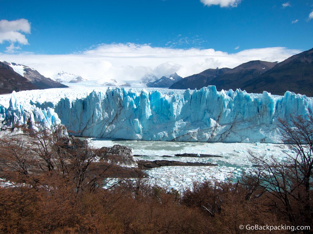 Look in the middle to see a giant pinnacle of ice falling off the glacier