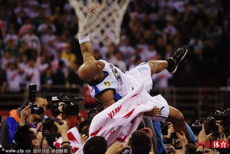 March 30th, 2012 - Stephon Marbury is lifted after he helped the Beijing Ducks win the CBA Championship
