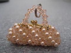 jewellery(0.0), earrings(0.0), art(1.0), pearl(1.0), gemstone(1.0), bead(1.0),