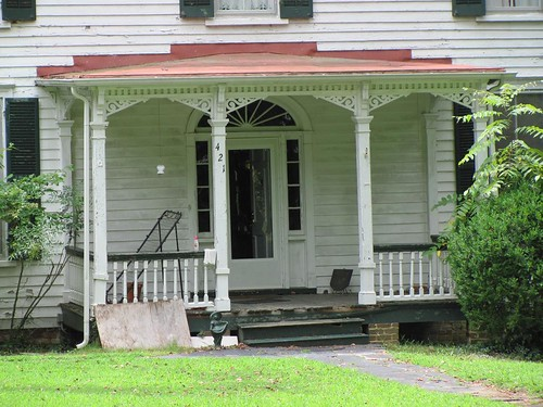 door wood roof house home metal architecture farmhouse facade sunrise square vent virginia capital bracket shed decoration front frieze symmetry domestic illusion frame embellishment vernacular sunburst panels railing domicile residence posts turned lacy angular entry gable transom cornice ornamentation dwelling pilaster hampdensydney sidelight princeedwardcounty millwork baluster semicircular dentil vergeboard bargeboard lowpitch centralentrance