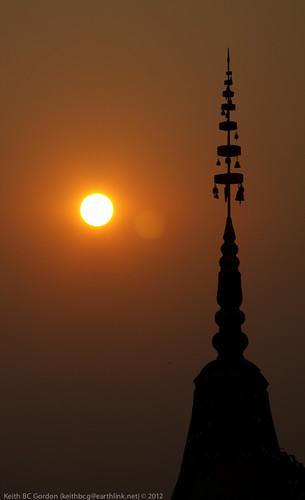 sunset silhouette temple haze laos huixia
