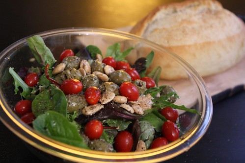 Mixed Greens with Lemon Garlic Olives, Grape Tomatoes, and Marcona Almonds