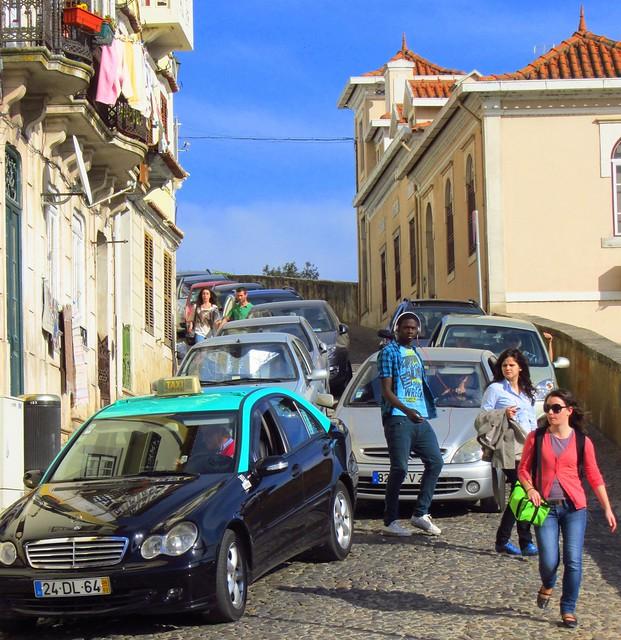 Coimbra University students negotiating the traffic, Coimbra, Portugal