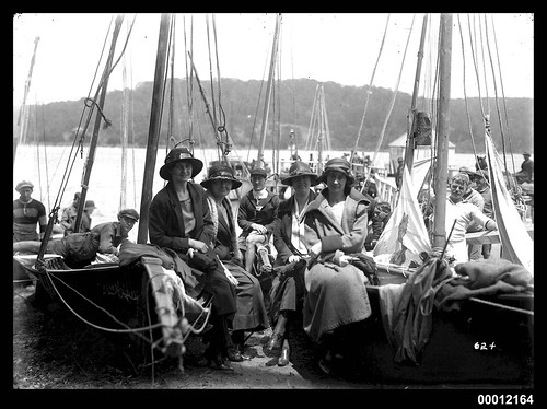 Women sitting on beached skiffs in Sydney Harbour