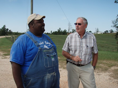 Cattle and poultry farmer Anthony Lovett and Supervisory District Conservationist Ron Read monitor the success of conservation practices, such as the incinerator and cross-fencing, on his Jasper County farm.
