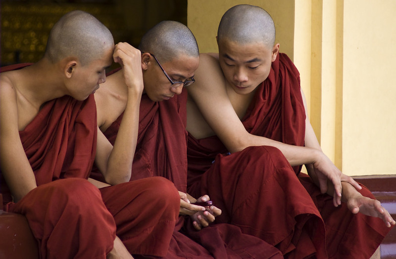 Burmese Monks Distracted By Modern Technology