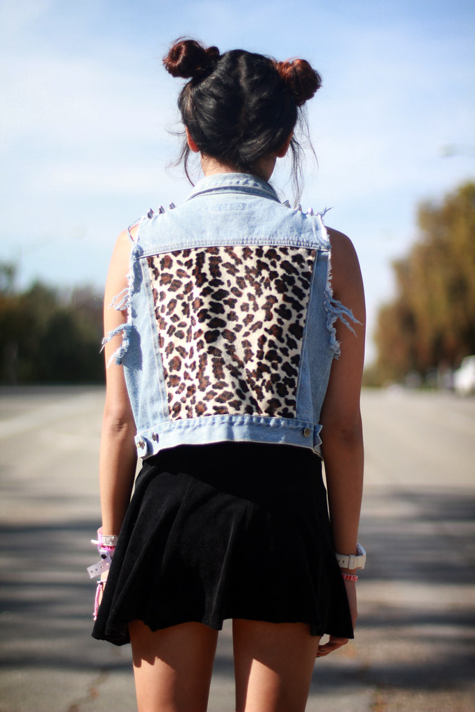 Tarte Vintage 90's Fashion Denim Destroyed vest with studded spikes on shoulder, velvet leopard cheetah back patch, velvet dress, blue lipstick from limecrime - available at shoptarte.com