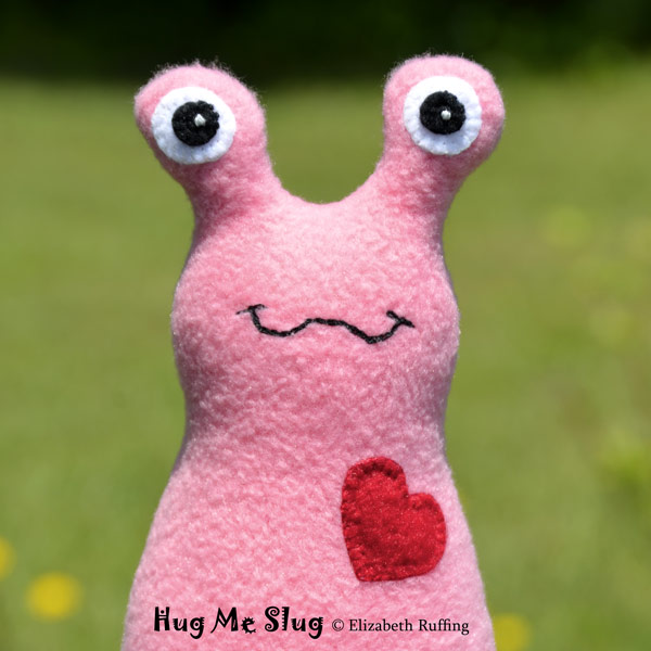 Medium pink Hug Me Slug, original art toys by Elizabeth Ruffing