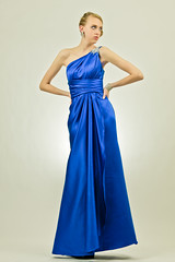 bridal clothing(0.0), aqua(0.0), sleeve(0.0), cocktail dress(0.0), wedding dress(0.0), bridesmaid(0.0), prom(0.0), bridal party dress(1.0), day dress(1.0), neck(1.0), textile(1.0), gown(1.0), clothing(1.0), cobalt blue(1.0), woman(1.0), female(1.0), satin(1.0), electric blue(1.0), blue(1.0), person(1.0), dress(1.0),