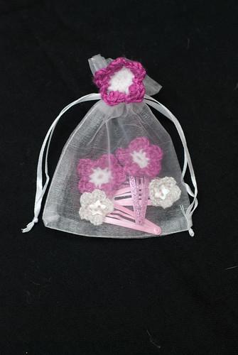 Flowery hair slides in gossamer bag