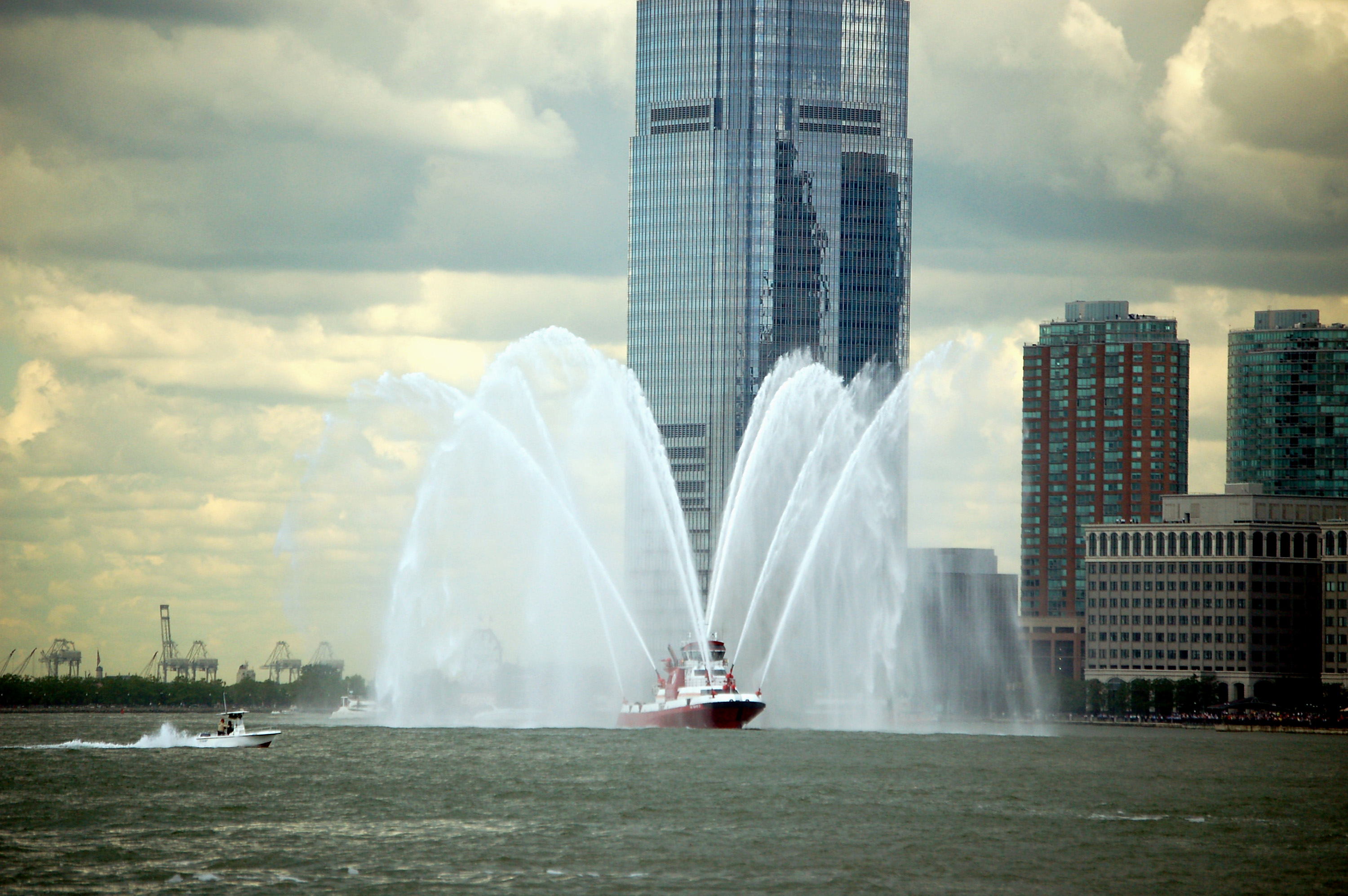 A fire boat leads the Enterprise up the Hudson
