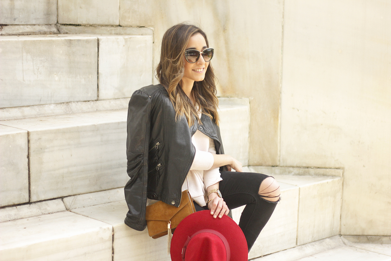 black biker jacket ripped jeans red hat camel bag outfit fashion style spring13