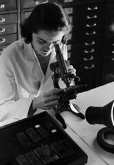 [Woman using microscope, St. Luke's Hospital, U.S. Industrial Alcohol Company]