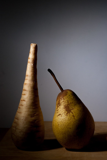 An uncooked parsnip and pear