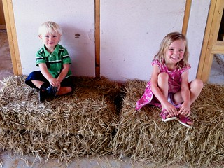 Kids on some of the last bales in the house
