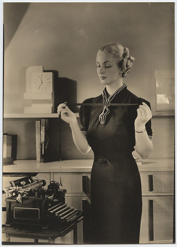 [Woman holding typewriter ribbon at Royal Typewriter]