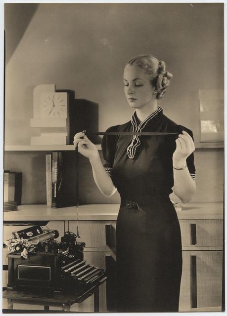 [Woman holding typewriter ribbon at Royal Typewriter] from Flickr via Wylio
