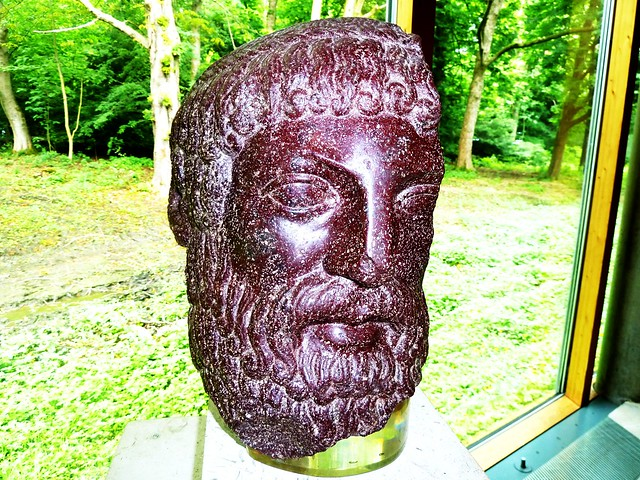 Roman porphyry head of Zeus or Poseidon, Burrell Collection