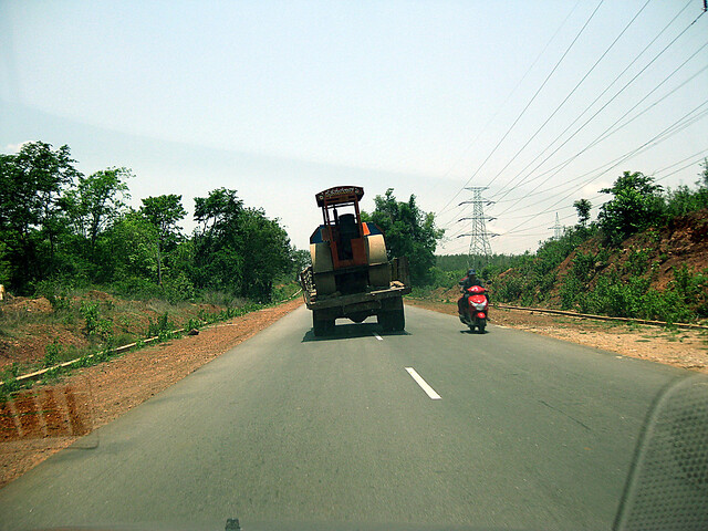 road roller on truck, on NH216, on the way to jog falls