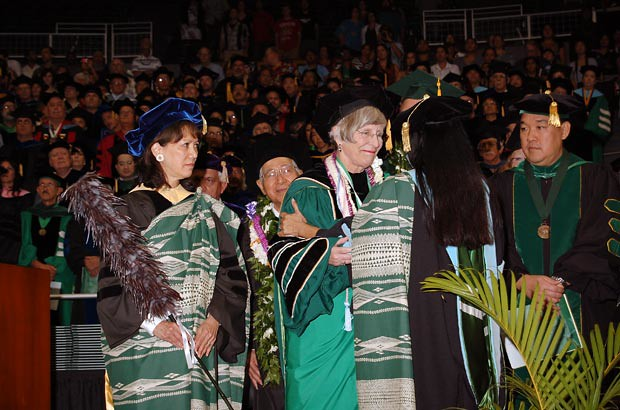 <p>UH Manoa Chancellor Virginia Hinshaw is presented with a gift during Manoa's commencement ceremony from the campus' deans and directors for her service to the university</p>