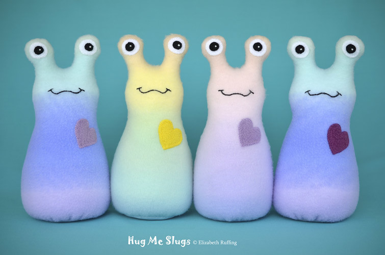 Rainbow Hug Me Slugs, original art toys by Elizabeth Ruffing