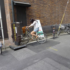 Kyoto Woman Sleeping on Bicycle