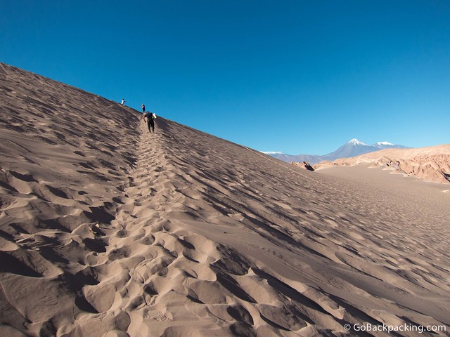 It's a slow, hot slog up the sand dune