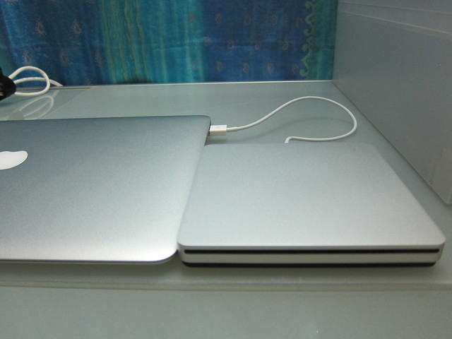Apple USB SuperDrive - Beside The MacBook Air