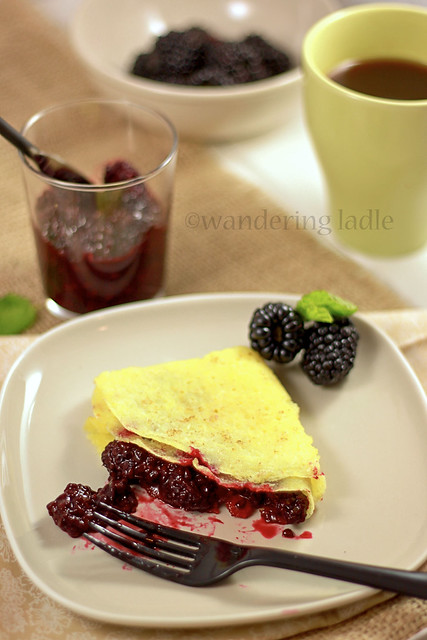 Gluten free vegan crepes with black berry compote