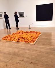 Strangers contemplating Invisible Hole Revealed by the Shadow of the Artist (Keith Arnatt) & No. 62 (Black/Blue/Violet/Blue) (Bob Law) behind Soul City (Pyramid of Oranges) (Roelof Louw)