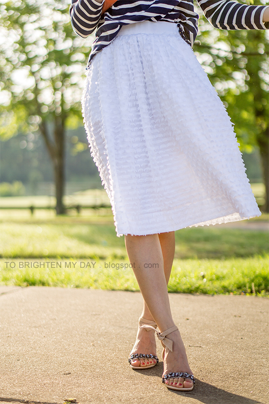 navy striped top with pom poms, white midi skirt, jeweled sandals