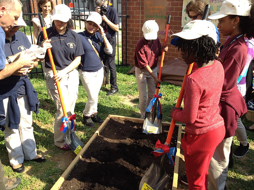 Students from Columbia Heights Educational Campus participate in the symbolic first dig in their new garden.  The People's Garden will grow food for both the school and people in need.