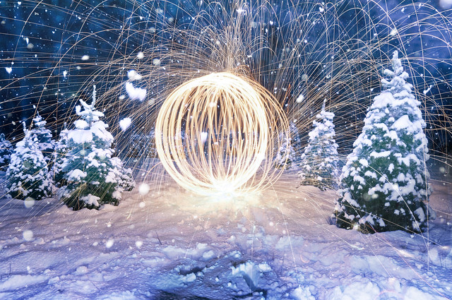 Steel wool long exposure light painting with on-camera flash freezing snow flakes falling