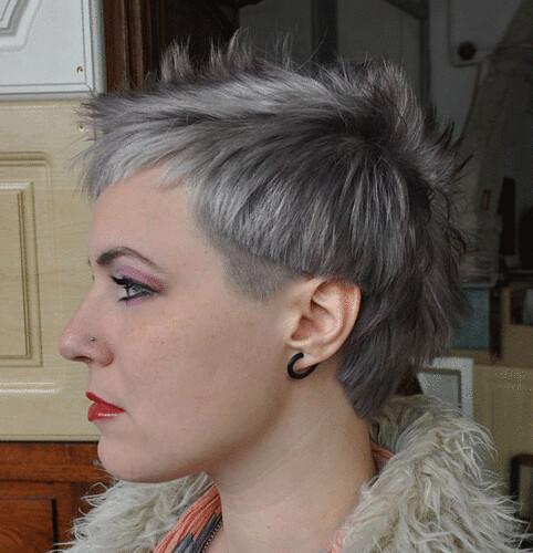 bi level bob haircut bi level haircut with the sides clipped around the ears