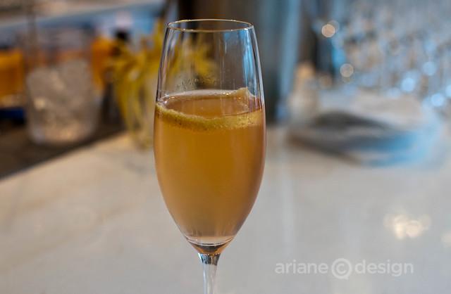Aperitivo Milano: gin, aperol, grapefruit syrup, prosecco, grapefruit twist