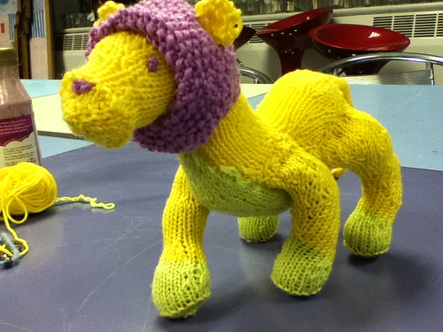 Knitted in the round intarsia toy lion improvised freeform knitting yellow