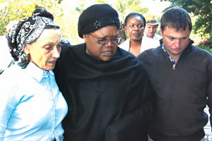 Republic of Zimbabwe Vice President Joice Mujuru with the widow of Sam Levy, Gloria, and their son, Maurice, at the family home in Avondale. Sam Levy was friends with Mujuru's late husband Gen. Solomon Mujuru. by Pan-African News Wire File Photos