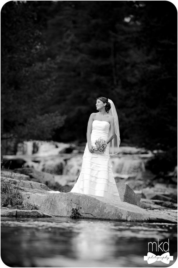 Bride standing in the waterfalls - Jackson, NH