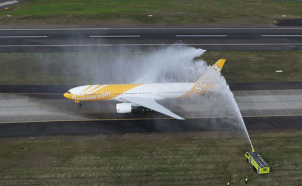 Inaugural Scoot commercial plane to land in Sydney,  greeted by fire-engine trucks hosing if off as a grand welcome last year (photo by JAMES MORGAN)