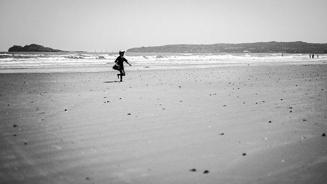 Boy on the beach - Portmarnock, Ireland - Black and white street photography