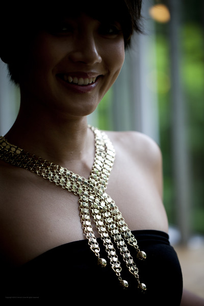 Fabulous gold-toned necklace that criss-crosses over your decolletage - reminds us of a waterfall somewhat. Stunning!