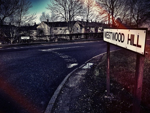 picture of a road sign in Westwood, East Kilbride, trying to mimic the Hollywood sign, California